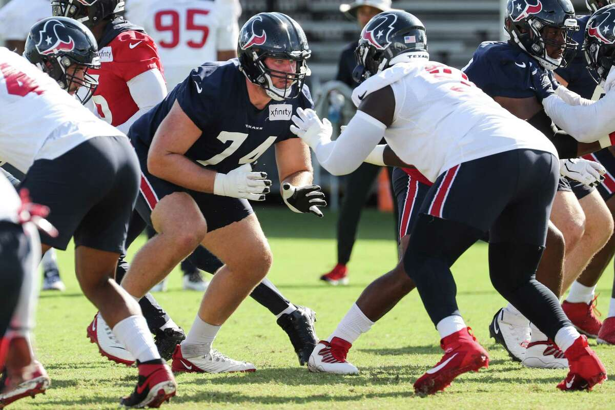 Houston Texans offensive guard Max Scharping (74) breaks off the ball during an NFL training camp football practice Thursday, Aug. 12, 2021, in Houston.