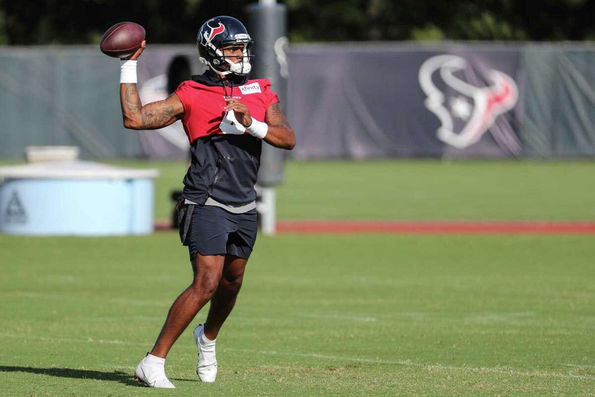 Houston Texans quarterback Deshaun Watson throws a pass during an NFL training camp football practice Thursday, Aug. 12, 2021, in Houston.