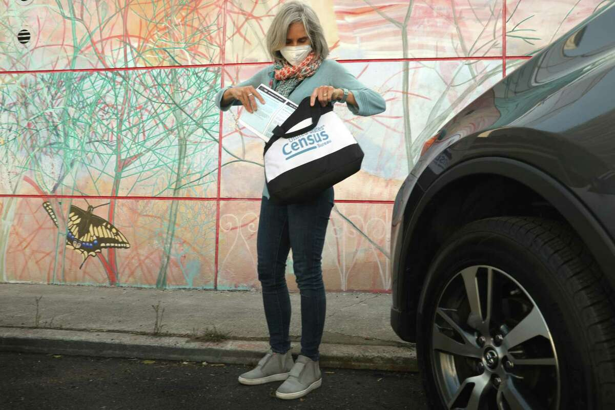 Census enumerator Amy Tanner walks on San Jose Ave. in her neighborhood on Thursday, Sept. 17, 2020, in San Francisco, Calif.