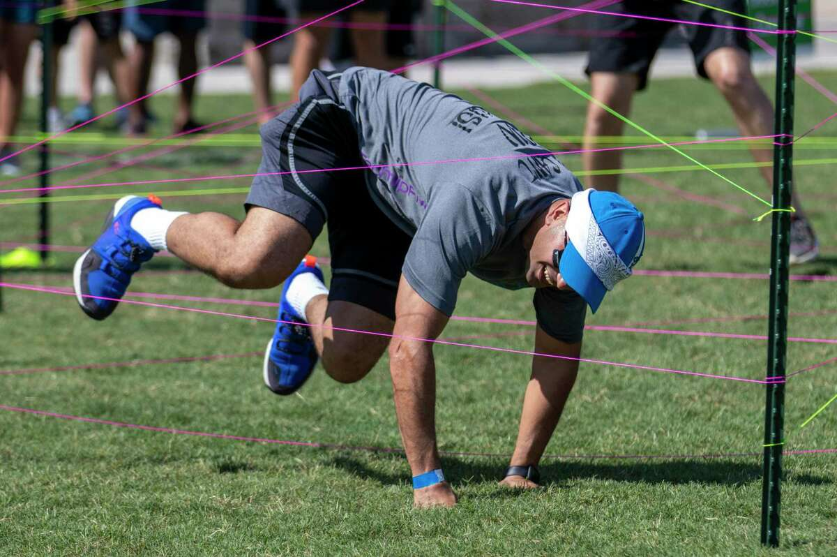 Muataz Adehaidah jumps over strings arranged into a piece of an obstacle course during the 21st annual Dragon Boat Races on Thursday, September 26, 2019 at Northshore Park in The Woodlands.
