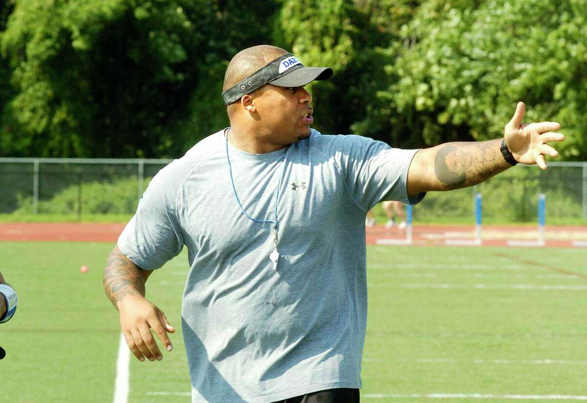 Coach Idris Price during Darien High School football practice in Darien in 2010. Price, who was part of championship teams at McMahon, including the 1994 team that went 12-0 and won FCIAC and CIAC Class MM championships, and is the program's all-time rushing leader, will be Norwalk's defensive coordinator. Price also won a Super Bowl with the Tampa Bay Bucaneers in 2003.