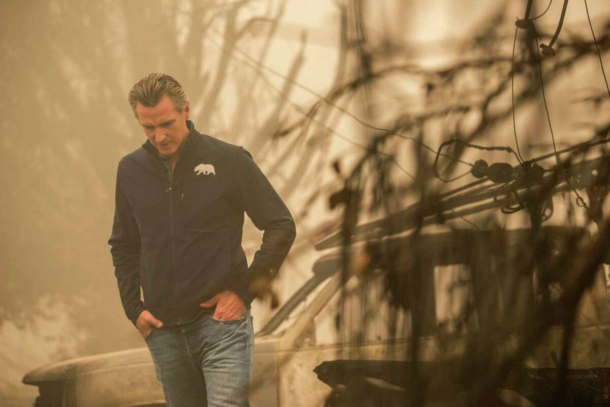 Gov. Gavin Newsom, the target of a recall drive, visits Greenville (Plumas County) as the Dixie Fire rages last weekend.