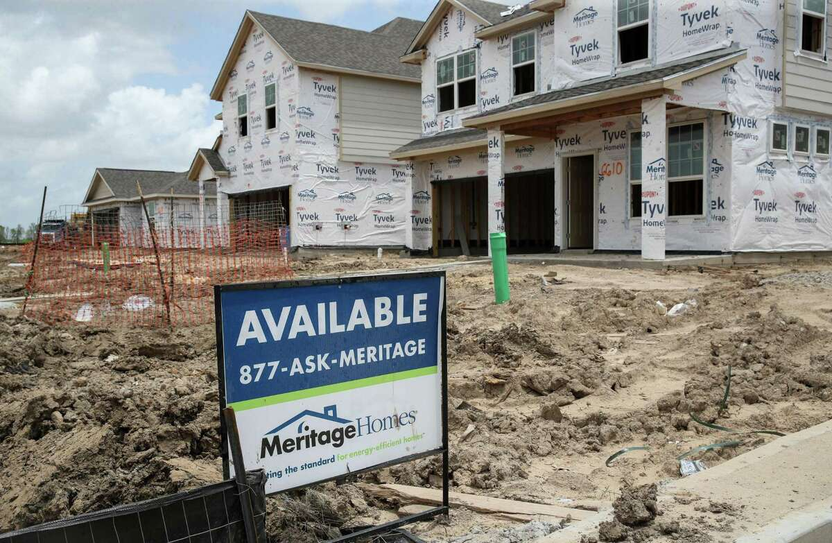 A for sale sign sits in front of a home as construction continues in the Grand Trails subdivision Wednesday, June 9, 2021, in Richmond. Builders plan to construct 129 homes in the subdivision.