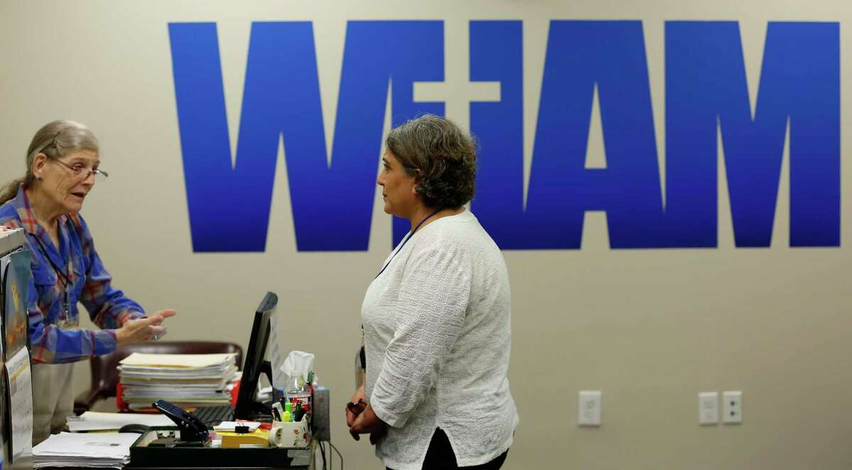 Volunteers Susan Meer (left) and Shohreh Marashi talk at the West Houston Assistance Ministries Monday, Aug. 19, 2019, in Houston.