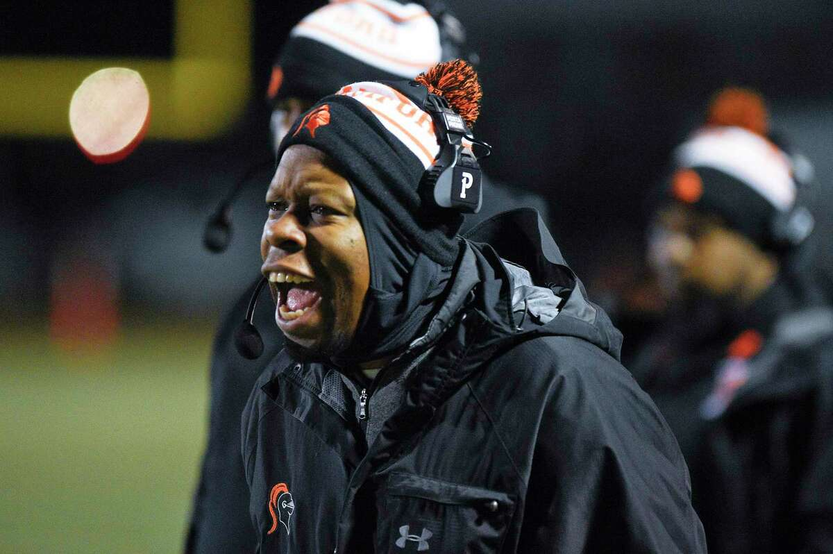 Stamford coach Jamar Greene shouts to his players in the first half of a FCIAC football game against St. Joseph at Boyle Stadium on Nov. 22, 2019 in Stamford, Connecticut. St. Joseph won 58-0.