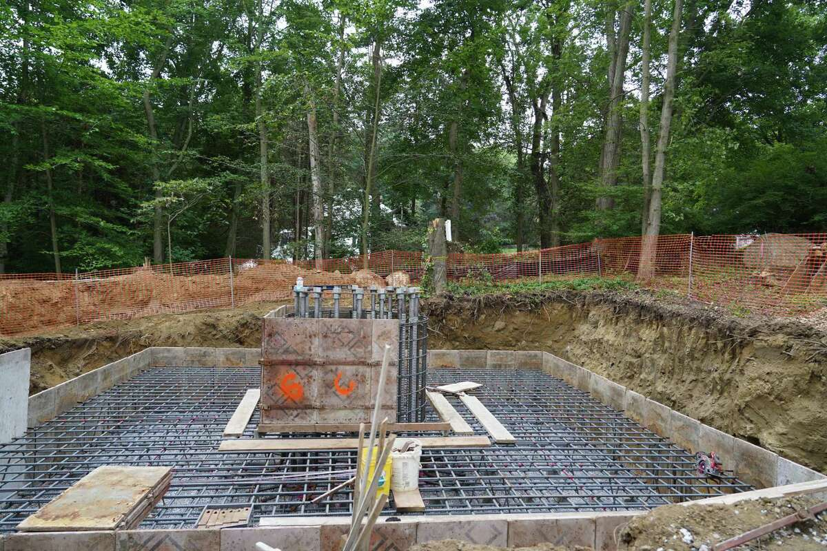 Construction on the Keith Richey property at 183 Soundview in New Canaan has started. His house can been seen behind it.