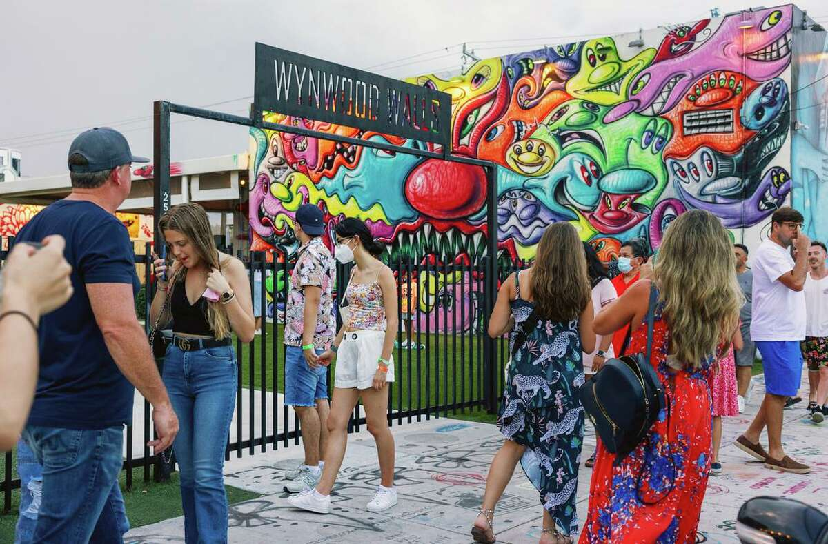 Wynwood, a Miami arts district once filled with neglected warehouses, is now home to startup incubators and upscale restaurants as tech firms move in.