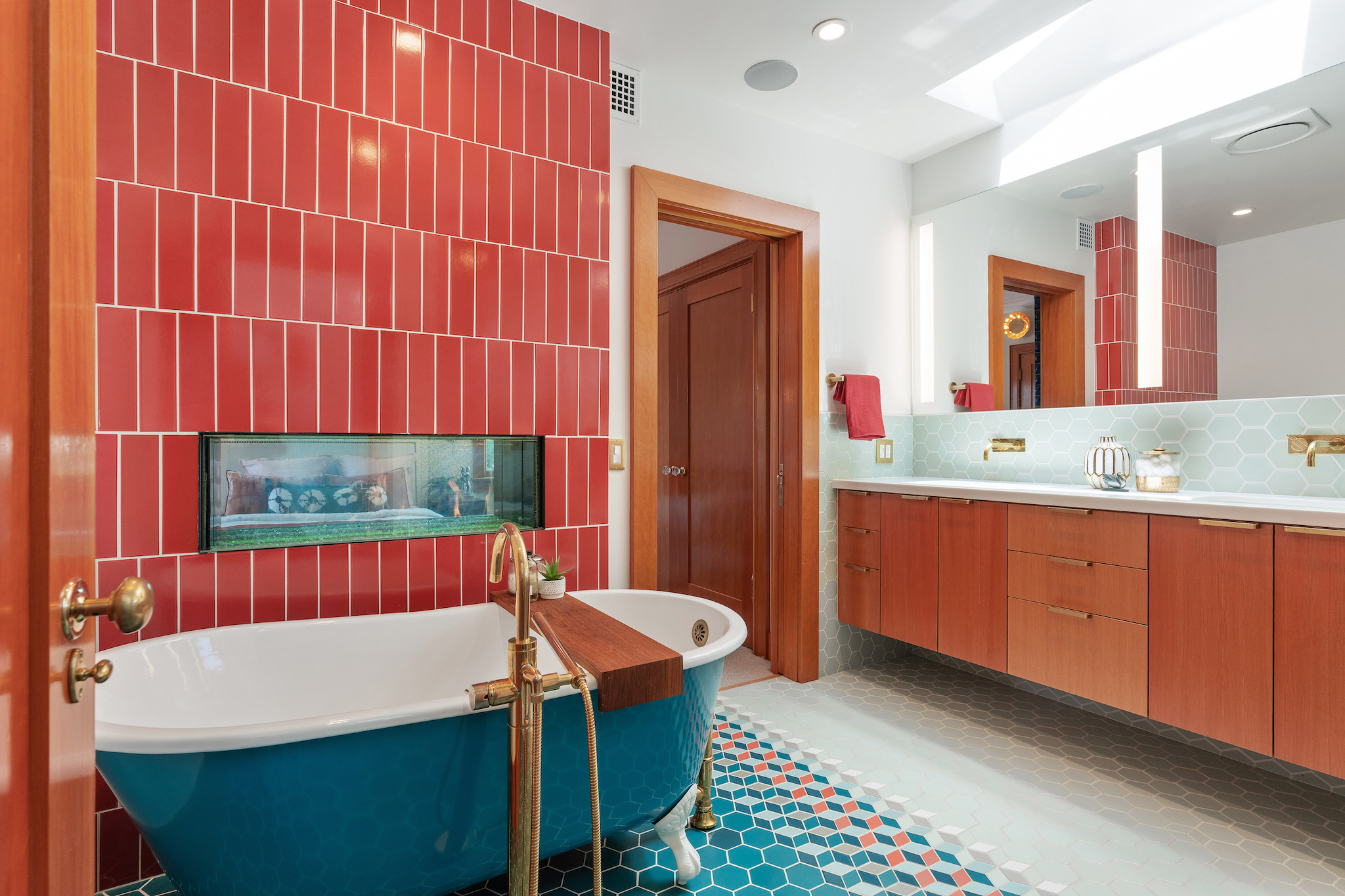 The fireplace you see in the primary bath suite is two sided, shared with the primary bedroom.