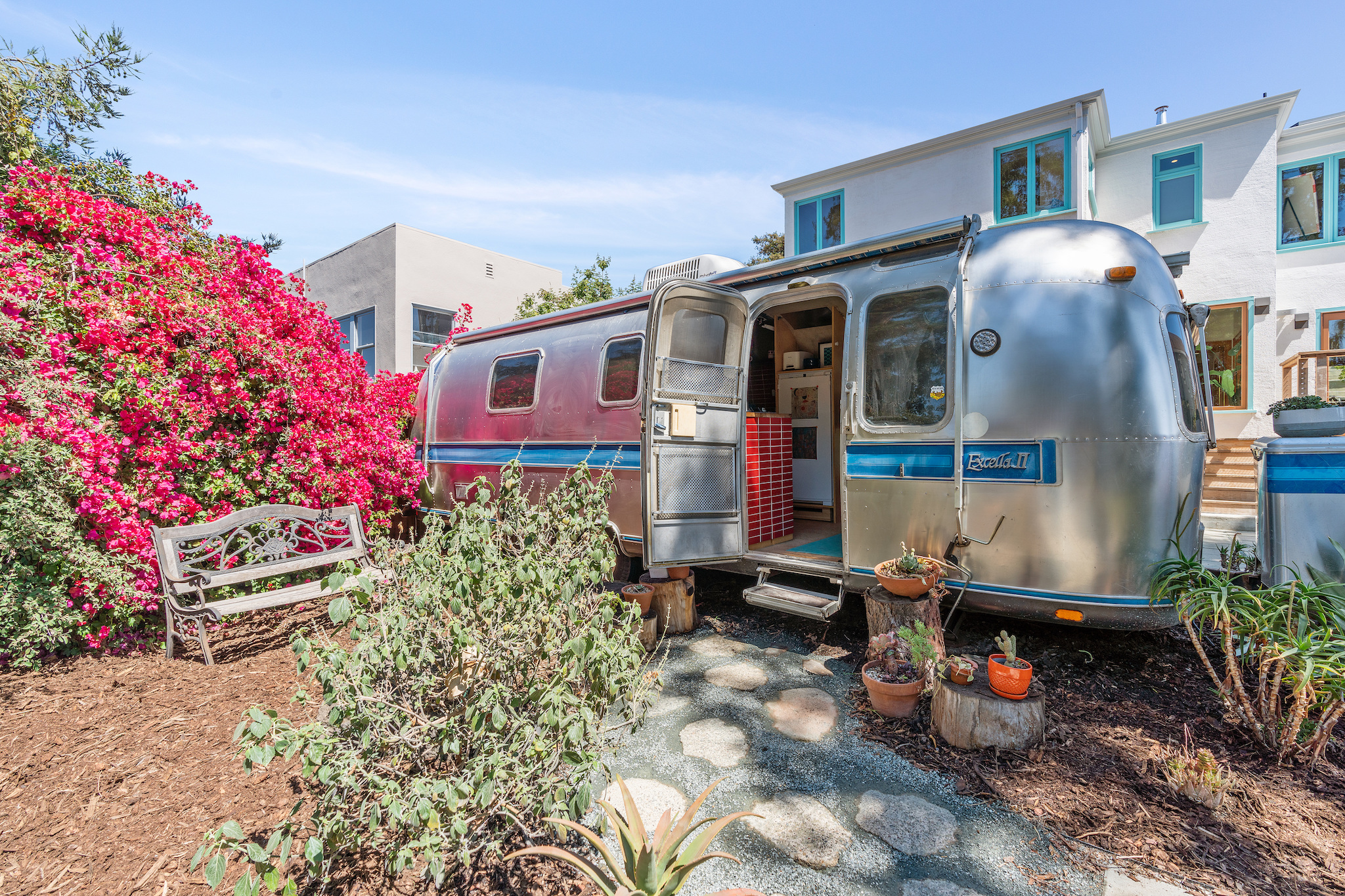 A fully equipped one-bedroom Airstream completes the scene.