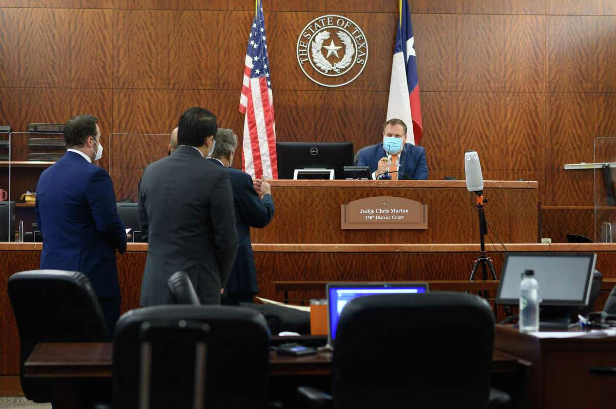 Gene Wu appears with his lawyers at the Harris County Courthouse on Wednesday, Aug. 11, 2021. State District Judge Chris Morton granted a writ of habeas corpus for State Rep. Gene Wu, pre-empting a civil arrest warrant for his absence in the Texas Legislature.