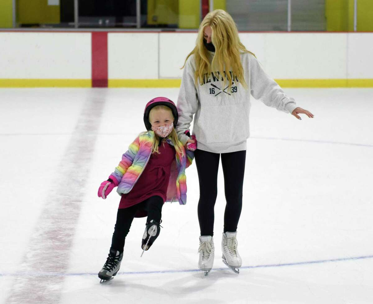 Joy Erickson, 5, of Darien, learns to skate with instructor Talia Klein at the ice skating and hockey summer camp at Terry Conners Rink in Stamford, Conn. Monday, Aug. 9, 2021. More than 80 kids ages five through 15 participated in the eight week camp, which is now in its final week. The camp is available for a half day or full day to children of all skill levels. Children will learn basic ice skating skills and can progress to more advanced groups where they'll have the chance to learn figure skating and hockey.