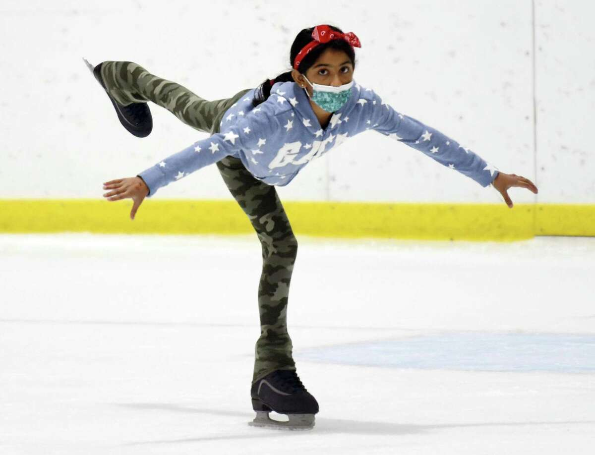 Ahaana Singh, 9, of Stamford, gracefully glides across the rink at the ice skating and hockey summer camp at Terry Conners Rink in Stamford, Conn. Monday, Aug. 9, 2021. More than 80 kids ages five through 15 participated in the eight week camp, which is now in its final week. The camp is available for a half day or full day to children of all skill levels. Children will learn basic ice skating skills and can progress to more advanced groups where they'll have the chance to learn figure skating and hockey.