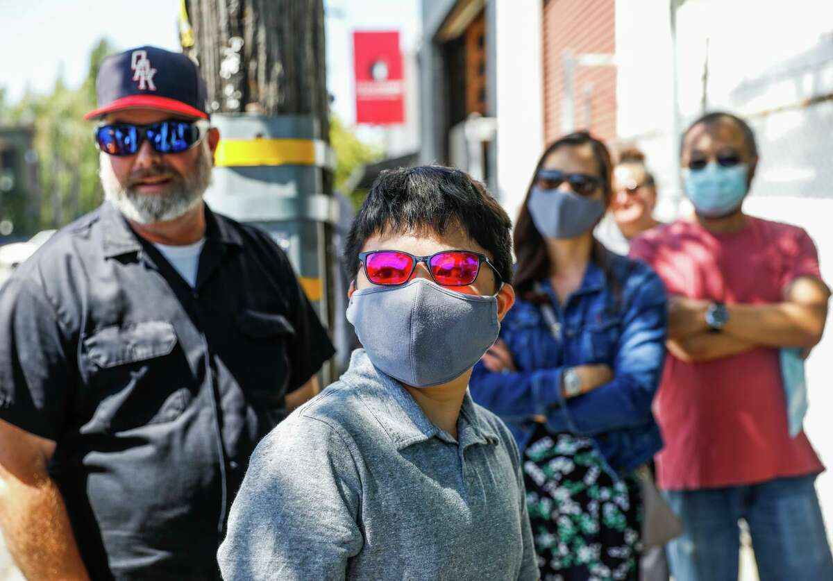 Benjamin Kai Lee (center) of Antioch uses EnChroma's sunglasses, which aid those with colorblindness.
