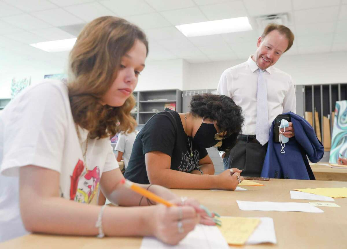 Montgomery ISD Superintendent Heath Morrison visits with Lake Creek High School students as he tours several campuses on the first day of school, Thursday, Aug. 12, 2021, in Montgomery. For the first time since 2019, students across the district began the school year attending classes on campus after the coronavirus pandemic forced schools to begin last fall online.