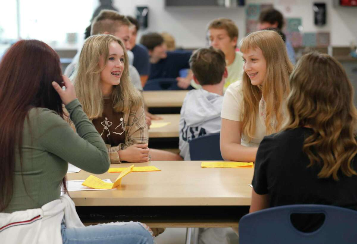 Lake Creek student Allison Taylor, left, visits with Ava Wilson visit before the start of art class on the first day of school, Thursday, Aug. 12, 2021, in Montgomery. For the first time since 2019, students across the district began the school year attending classes on campus after the coronavirus pandemic forced schools to begin last fall online.