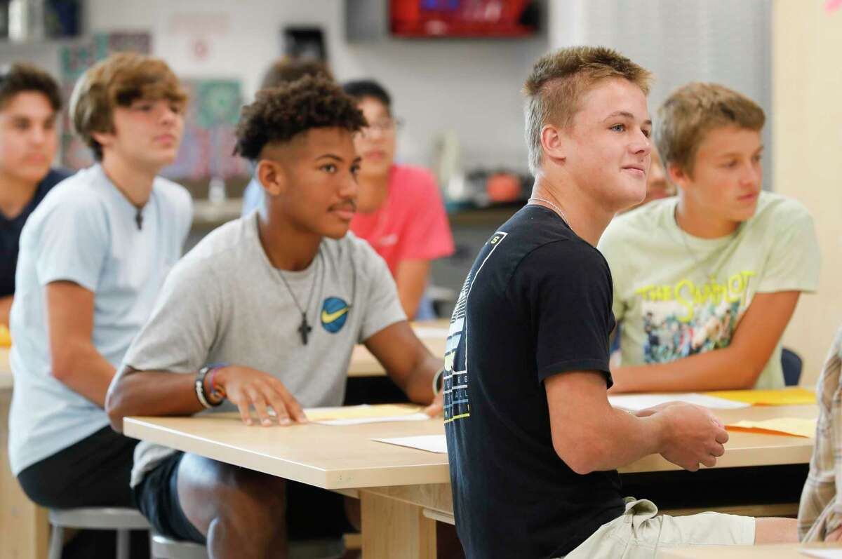 Lake Creek High School student Davis Lee listens on the first day of school, Thursday, Aug. 12, 2021, in Montgomery. For the first time since 2019, students across the district began the school year attending classes on campus after the coronavirus pandemic forced schools to begin last fall online.