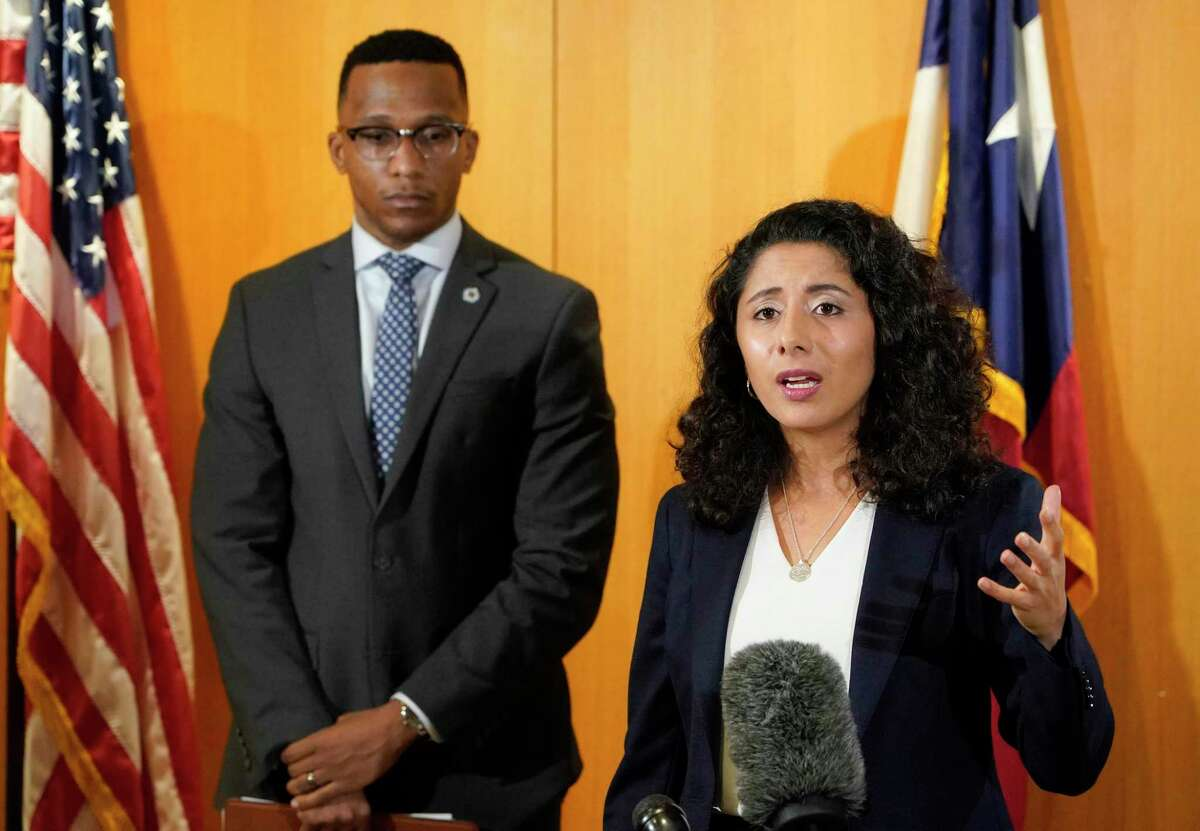 Harris County Attorney Christian Menefee, left, and Harris County Judge Lina Hidalgo, right, are shown during press conference Wednesday, June 23, 2021 in Houston. Menefee on Thursday sued Gov. Greg Abbott over his executive order barring local governments from enacting measures to protect the public from COVID-19.