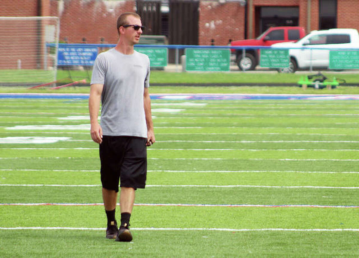 Carlinville boys soccer coach Tim Johnson watches his team go through a drill Thursday morning in the artificial turf field at CHS.