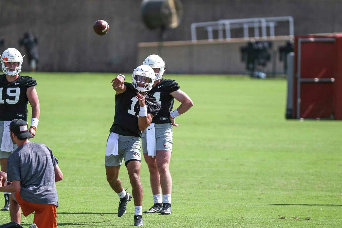 Texas quarterback Casey Thompson throws a pass during an NCAA college football practice Saturday, Aug. 7, 2021, in Austin, Texas. (Aaron E. Martinez /Austin American-Statesman via AP)
