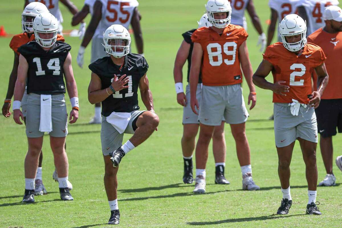 Texas junior quarterback Casey Thompson (11) spent years waiting for his chance, and after a strong performance in last year's Alamo Bowl, is part of a fierce competition to fill the void left by Sam Ehlinger under new coach Steve Sarkisian.