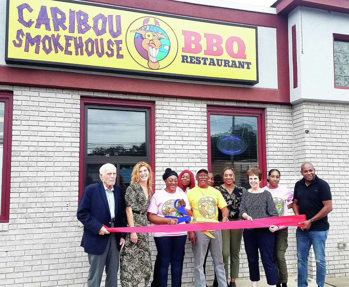 Caribou Smokehouse BBQ Restaurant in Middletown marked its grand opening Aug. 4. From left are Middlesex County Chamber of Commerce President Larry McHugh, Cavanaugh & Co. owner Juliet Cavanaugh, Smokehouse owner Elaine Wilson, employee Candy Allstate, owner's father Randolph Taylor, sisters Marcia Taylor and Nordia Taylor, Chamber Chairwoman Maureen Westbrook, owner's daughter Preshawna Wilson and husband Valen Wilson.