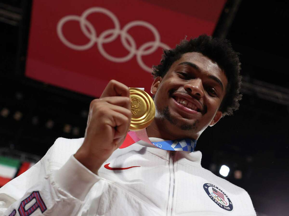 SAITAMA, JAPAN - AUGUST 07: Keldon Johnson #4 of Team United States poses for photographs with his gold medal during the Men's Basketball medal ceremony on day fifteen of the Tokyo 2020 Olympic Games at Saitama Super Arena on August 07, 2021 in Saitama, Japan. (Photo by Gregory Shamus/Getty Images)