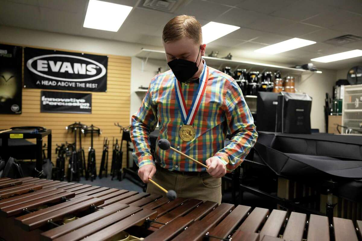 """Joseph """"Tres"""" Salas sophomore at Oak Ridge High School and percussion player, plays the marimba at Oak Ridge High School, Tuesday, Aug. 10, 2021, in Conroe. Salas placed at this year's UIL tournament in percussion."""