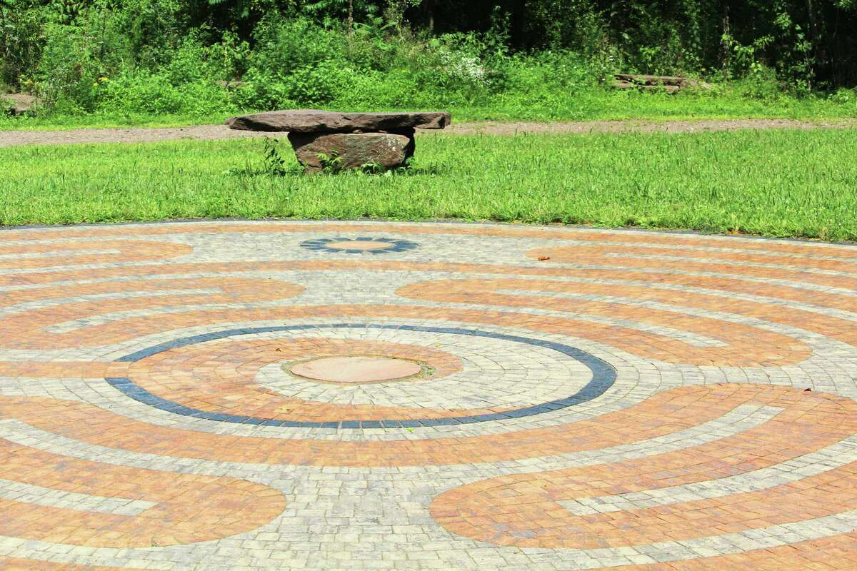 The new, 40-foot diameter labyrinth at Portland Riverfront Park allows users to make their way along a meditative path accented with brownstone from the town's quarries, as well as historic features such as railroad ties