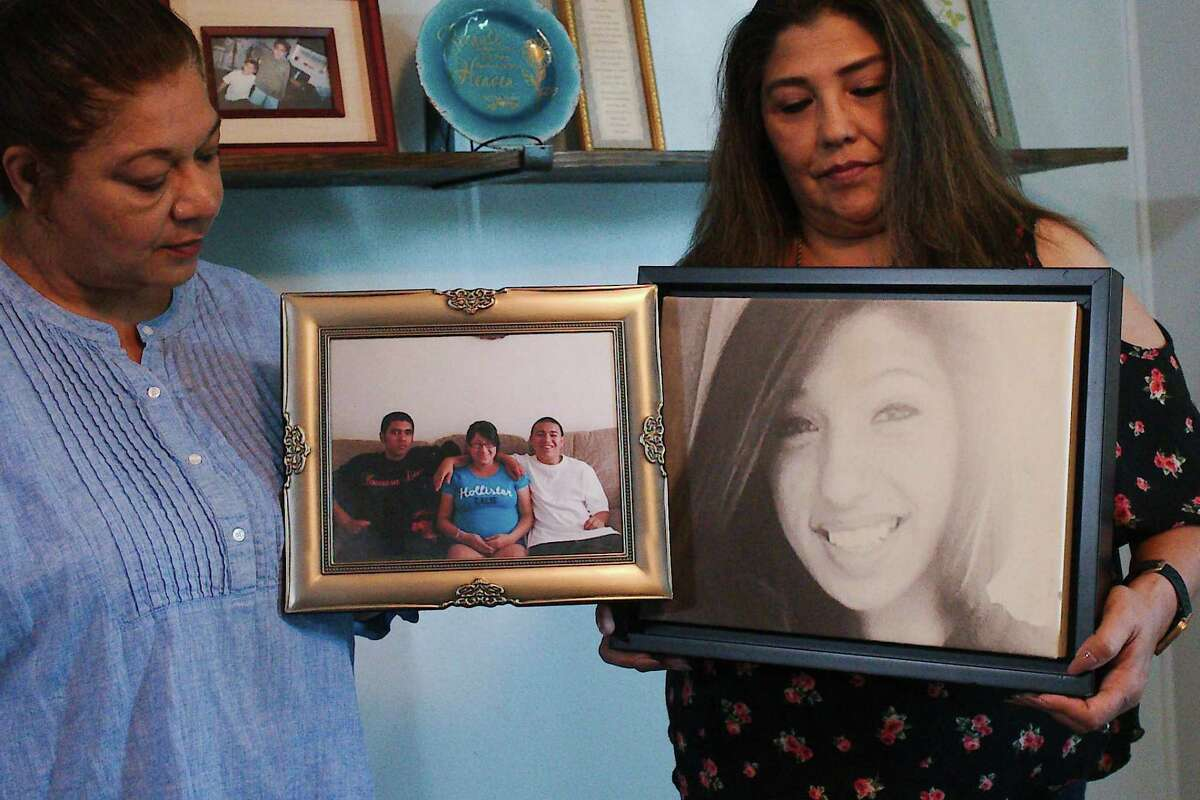Sandra Ramirez, left, holds a photo that shows her sons Paul and Tory, who died by suicide, sitting next to their sister Jessica Saenz. Beside Ramirez is Carolyn Gomez, who holds a photo of her daughter, Selena Cassandra Patina, who took her own life. Ramirez and Gomez are organizing a Pasadena walk to promote suicide prevention and awareness.