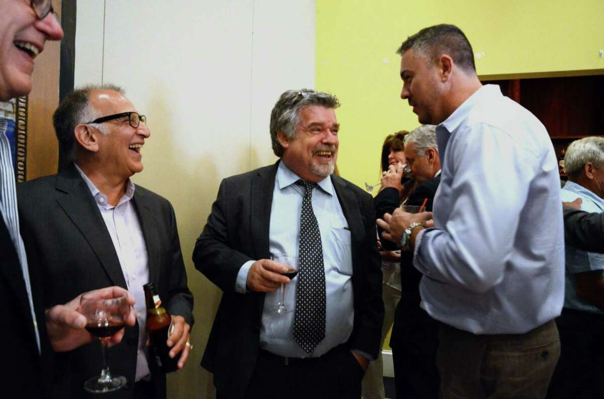 Former Ganim Campaign Manager Danny Roach, center, chats with Jose Tiago, right, during Mayor Joe Ganim's first fundraiser for his gubernatorial exploratory run at Testo's Restaurant in Bridgeport, Conn., on Thursday June 22, 2017. At left is Gary Flocco.