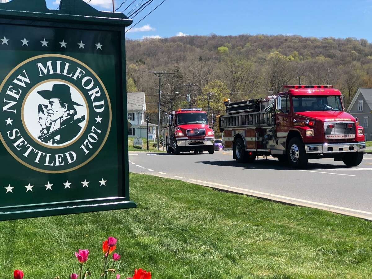 Spectrum/Water Witch Hose Co. #2 in New Milford spearheaded the first of a two-part Parade of Unity throughout town May 4, 2020. The parade featured fire trucks from Water Witch and Gaylordsville and Northville volunteer fire departments, other first responders, including police and ambulance vehicles, and Public Works trucks. The parade started at 1 p.m. and ended in late afternoon, after traveling through half the town. The second half of the parade will be held next Sunday, May 11. The parade route is listed on Water Witch's Facebook page. Above, the first of the fire trucks make their way along Bridge Street near the Village Green after leaving the firehouse. May 4, 2020