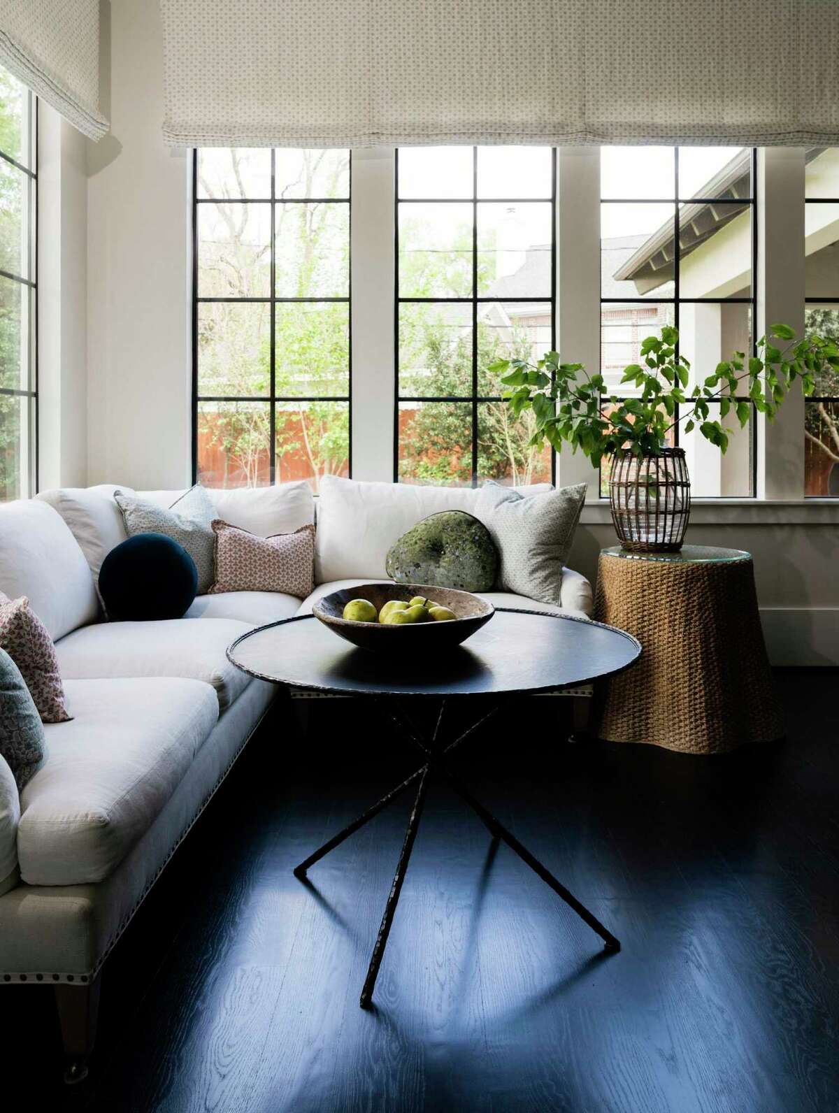 The non-traditional breakfast room has a linen-covered L-shaped sofa with a small table.