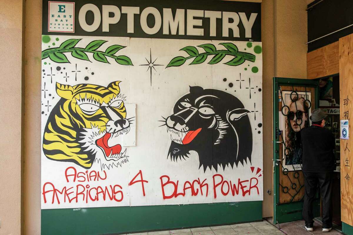 A mural in Oakland's Chinatown expresses support for the Black community in February.