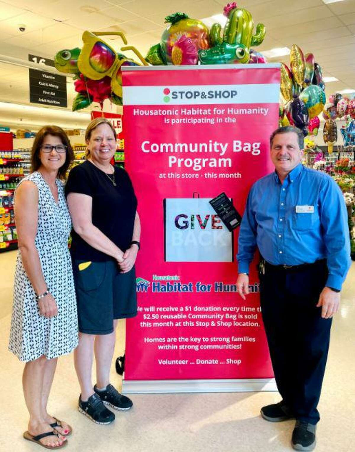The non-profit organization Housatonic Habitat for Humanity is the recipient of the Stop & Shop grocery store chain company's Community Bag Program in Ridgefield. April van der Noll, and Karen Petrazzini, who are the nonprofit organization's ReStore warehouse supervisors, are pictured with Ronald Salvatore, who is a store manager at the Stop & Shop. This is the first time this year that the non-profit organization has been chosen as the nonprofit (organization) of the month for the program, which was on a hold for over a year due to the coronavirus pandemic.