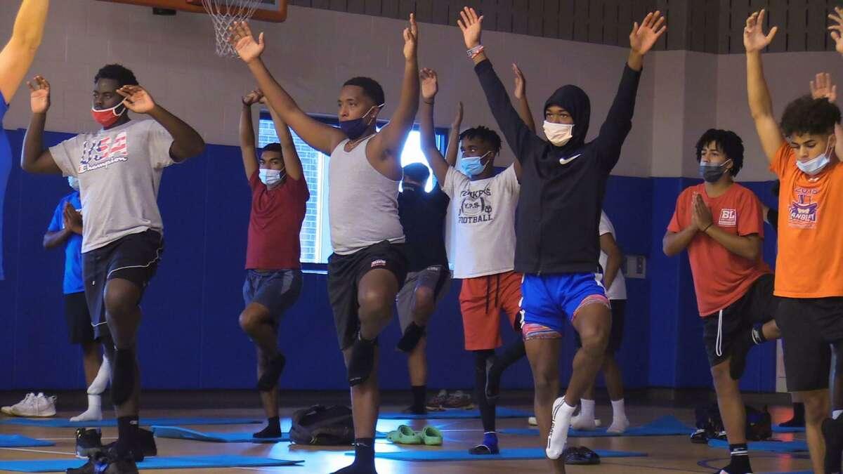 The Danbury football team participates in a yoga class on Thursday,.