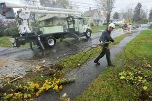 Danbury Forestry Department worker Doug Evanuska clears debris on Golden Hill Road during Hurricane Sandy's arrival in Danbury on Monday, Oct. 29, 2012.