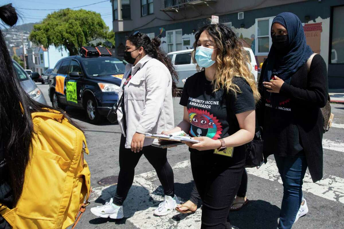 College student community vaccine ambassadors join a community pop-up vaccine effort in partnership with San Francisco's Department of Public Health and UCSF in the Excelsior District of San Francisco, Calif. Friday, June 18, 2021.