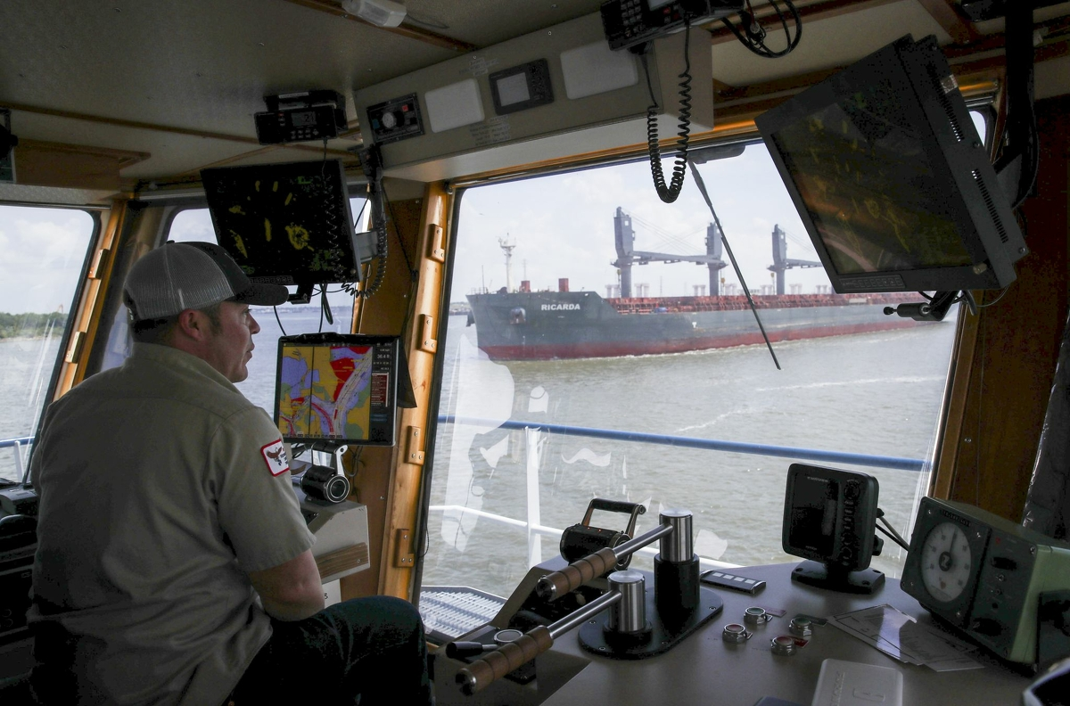 Paul Cousin, a relief captain, pilots a tow boat Monday, Aug. 2, 2021, in the Houston Ship Channel in Channelview.