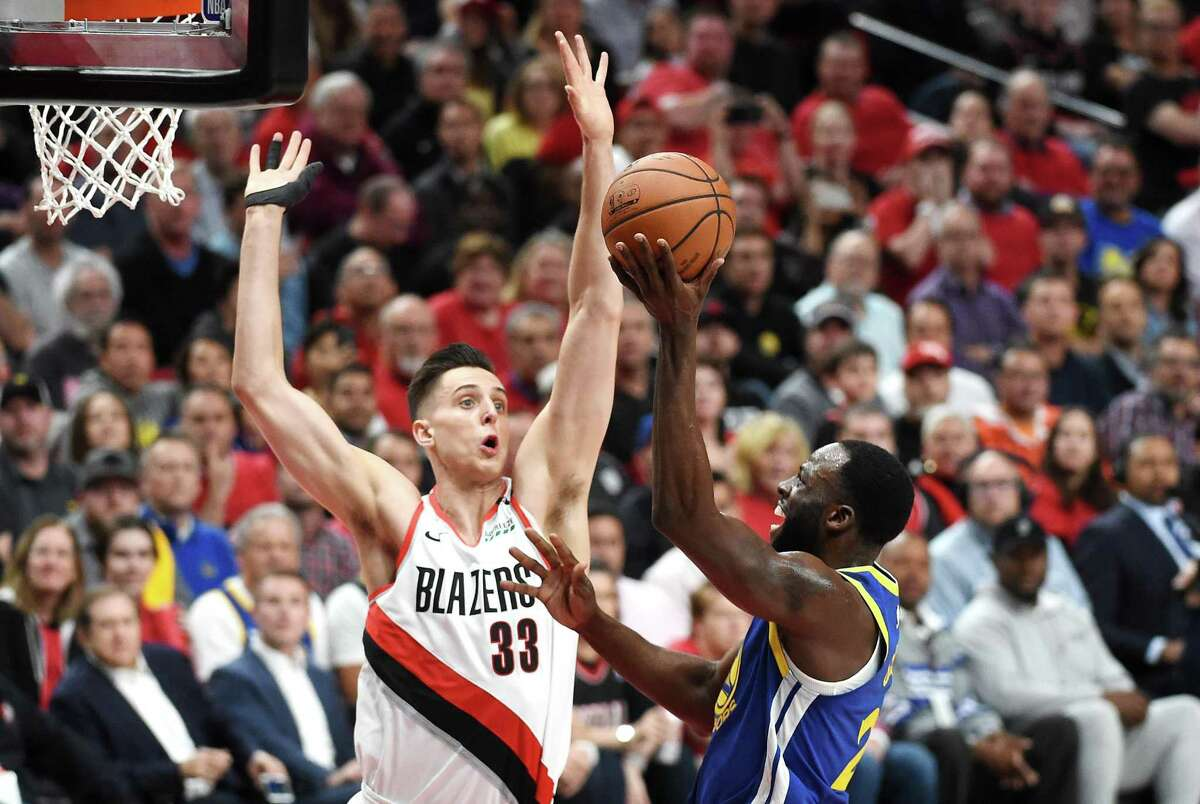 Draymond Green #23 of the Golden State Warriors shoots the ball against Zach Collins #33 of the Portland Trail Blazers during the first half in game four of the NBA Western Conference Finals at Moda Center on May 20, 2019 in Portland, Oregon.