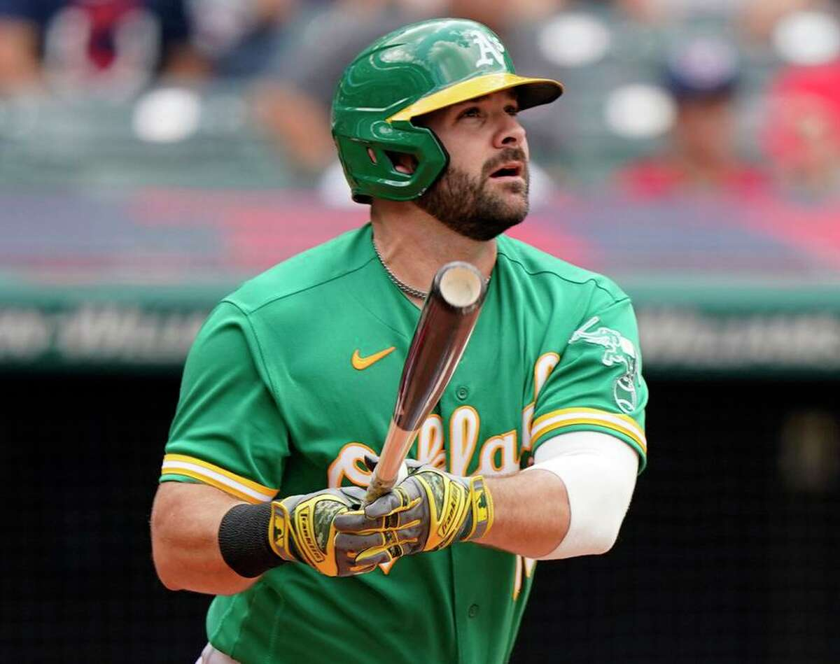 Oakland Athletics' Mitch Moreland watches his solo home run in the fifth inning of a baseball game against the Cleveland Indians, Thursday, Aug. 12, 2021, in Cleveland. (AP Photo/Tony Dejak)