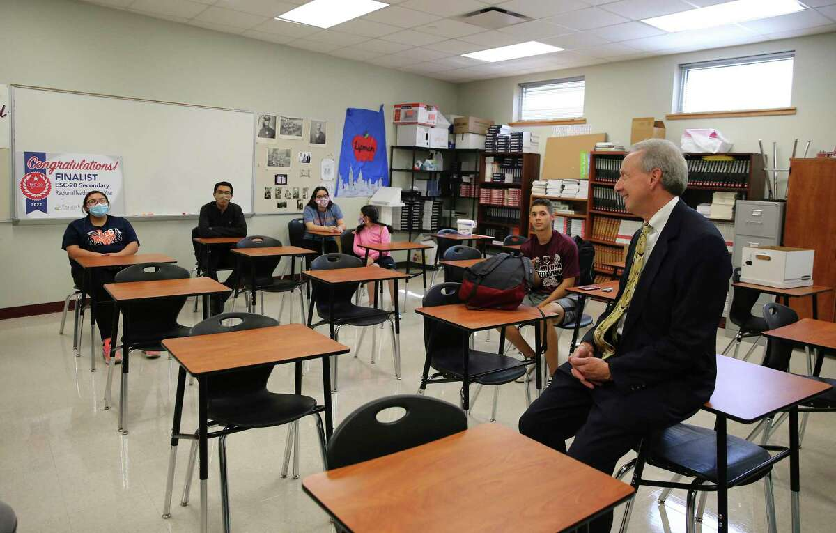 Noah Lipman, a social studies and economics teacher at Highlands High School in San Antonio ISD, chats with current and former students. A former lawyer from New York with a gritty yet empathetic teaching style, Lipman's commitment to working with economically disadvantaged students has brought high praise.