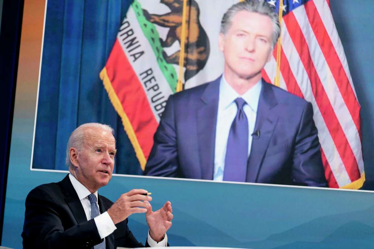 President Biden speaks with California Gov. Gavin Newsom via teleconference during a meeting with governors to discuss efforts to strengthen wildfire prevention, preparedness and response in July.