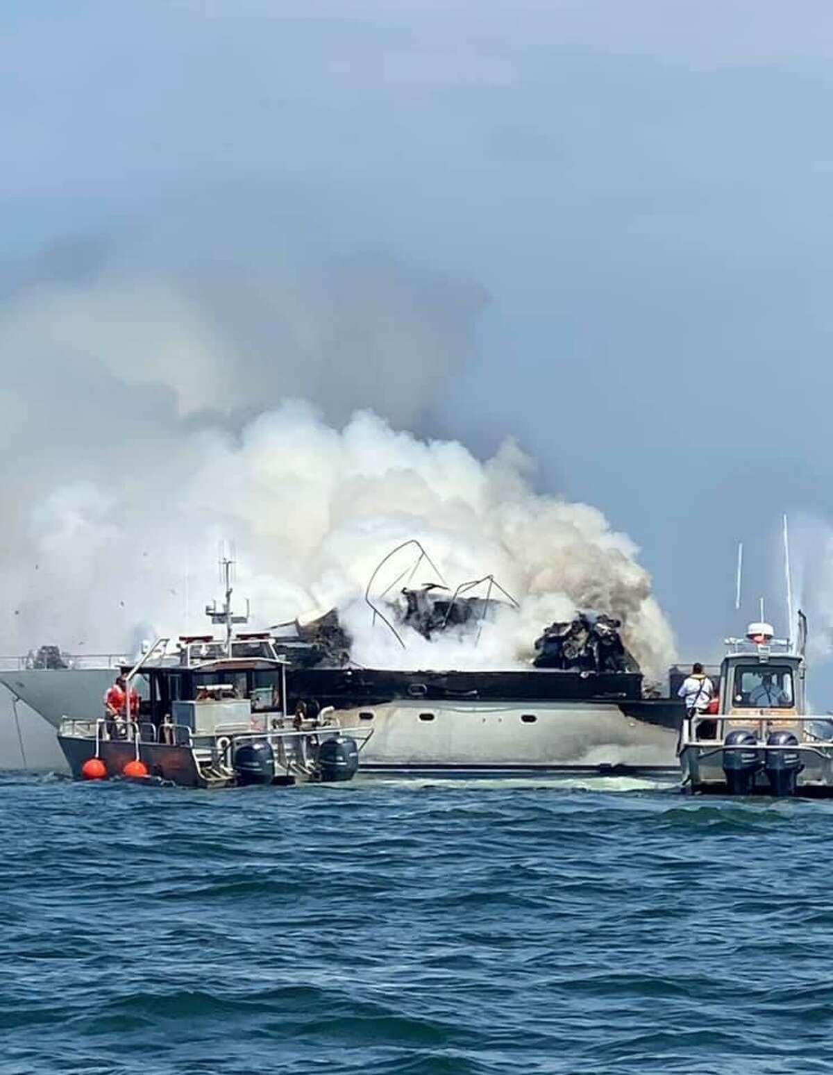 Eight passengers were rescued from this 70-foot yacht that caught fire Thursday afternoon.