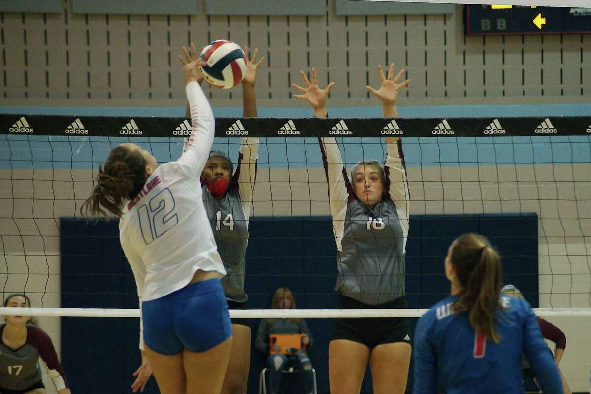 Austin Westlake's Caroline Pence (12) tries to hit a shot past Pearland's Aryelle Stevens (14) and Avery Schwartz (18) Thursday at Turner High School.