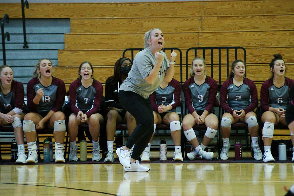 Pearland head volleyball coach Jamie Gill reacts to a point against Austin Westlake Thursday at Turner High School.