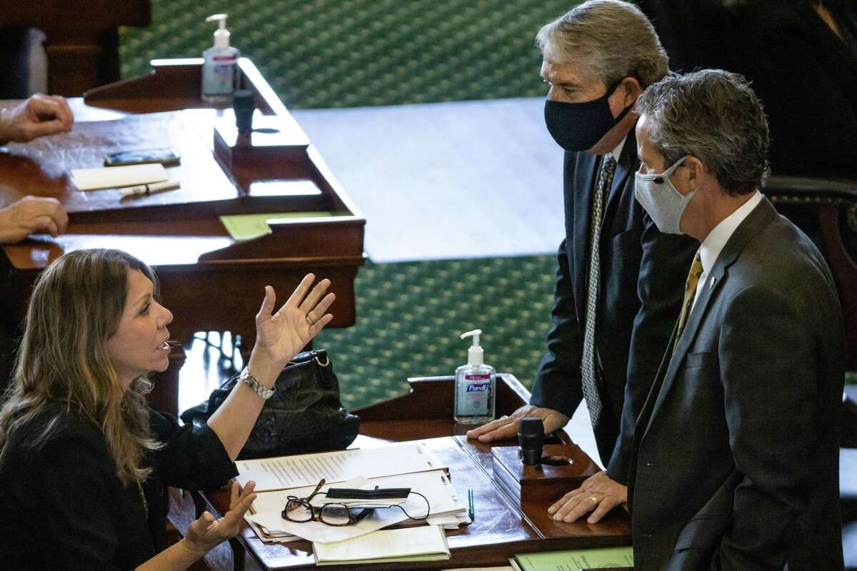 Texas State Senator Joan Huffman (R-Houston, left) meets with colleagues on the second day of the 87th Texas legislature on Wednesday, Jan. 13, 2021 at the Texas State Capitol, in Austin, Texas.