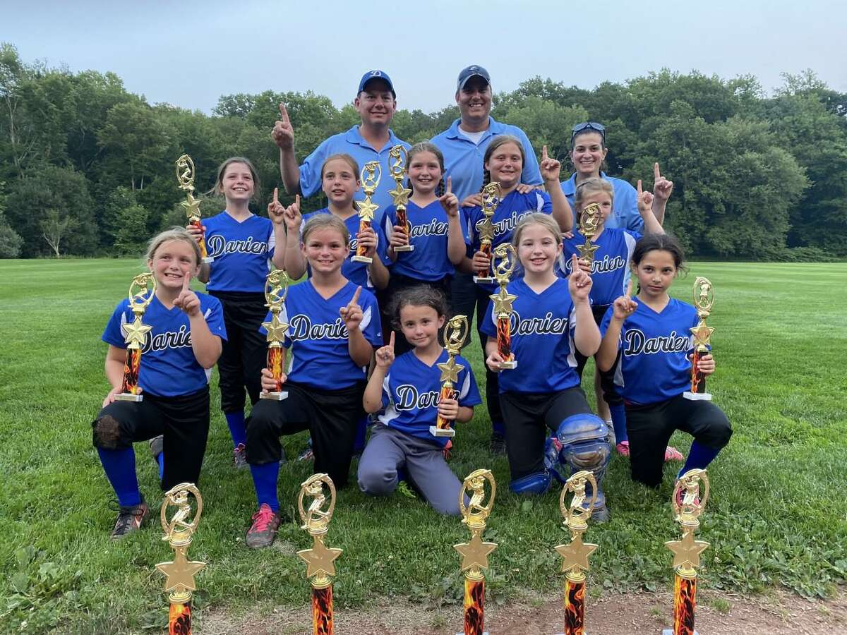 The Darien 8U Softball team recently won the annual Trumbull Invitational Softball Tournament 11-8 over Trumbull. Pictured from the left to the right in the front row are members of the team: Isla McNulty, Kaitlyn Cruikshank, Maddie McCarthy, Reagan Mullane and Evelyn Peloso. In the middle row are members of the team: Maeve Butler, Kendall Kaschel, Mia Laudicina, Ava Rongoe and Blaze Comfort. In the Back row are the coaches of the team: Sean McCarthy, Nick Rongoe and Michele Terra.