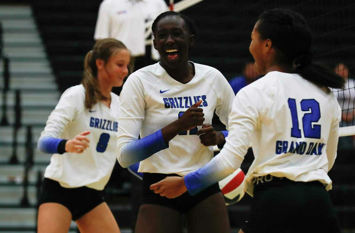 Grand Oaks' Jaela Auguste (11) reacts after blocking a shot during a high school volleyball tournament at Cedar Park High School, Thursday, Aug. 12, 2021, in Cypress.