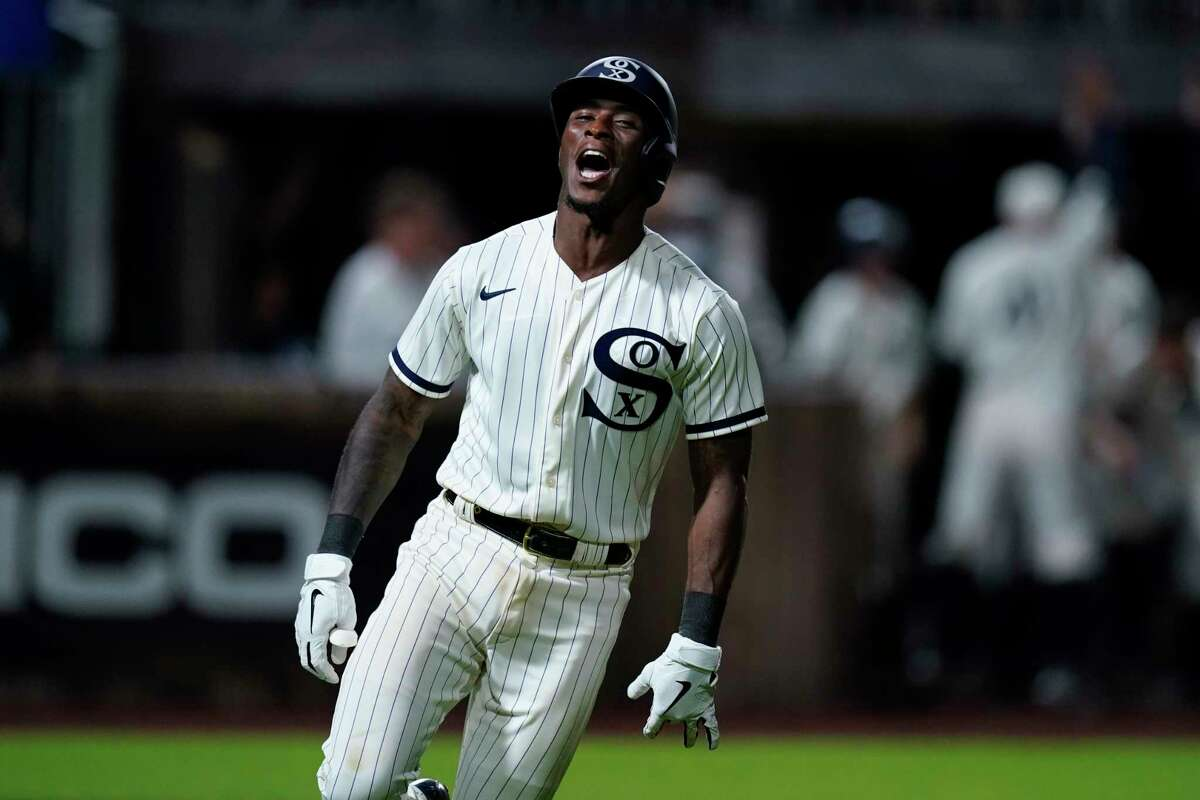 Chicago White Sox shortstop Tim Anderson (7) celebrates his walk-off home run against the New York Yankees in the ninth inning during a baseball game, Thursday, Aug. 12, 2021 in Dyersville, Iowa. The Yankees and White Sox are playing at a temporary stadium in the middle of a cornfield at the Field of Dreams movie site, the first Major League Baseball game held in Iowa. The White Sox won 9-8. (AP Photo/Charlie Neibergall)
