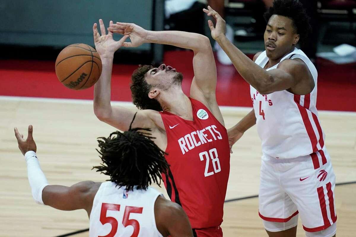 The Raptors' Scottie Barnes, right, fouls Rockets center Alperen Sengun during the second half Thursday.